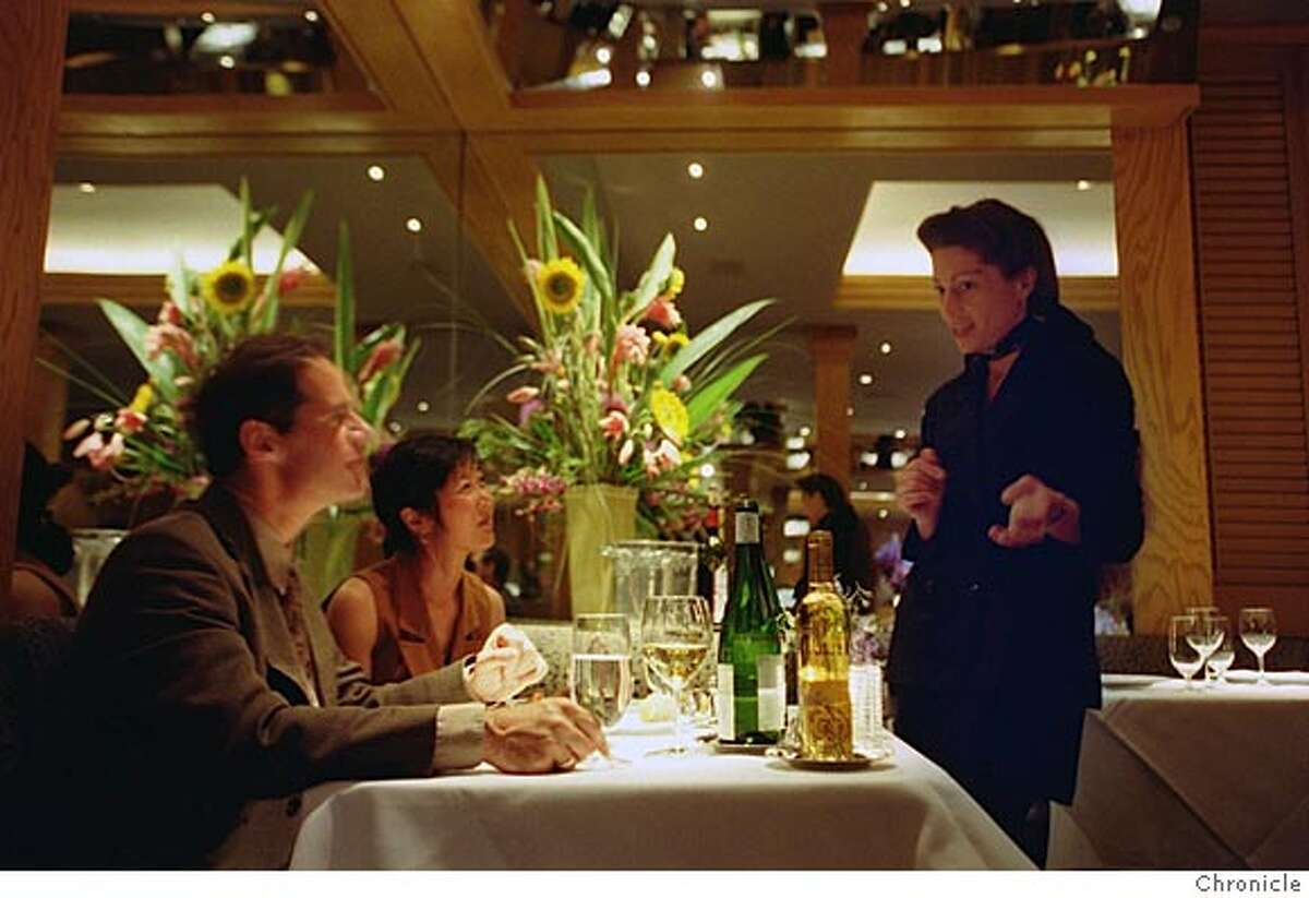 DANKO25A-C-22AUG99-FD-RW Pete Perry and his wife Toni Morozumi, left, chat with Renee-Nicole Kubin, the wine director, during dinner at Gary Danko at 800 North Point at Hyde near Fisherman's Wharf in San Francisco. BY ROBIN WEINER/THE CHRONICLE
