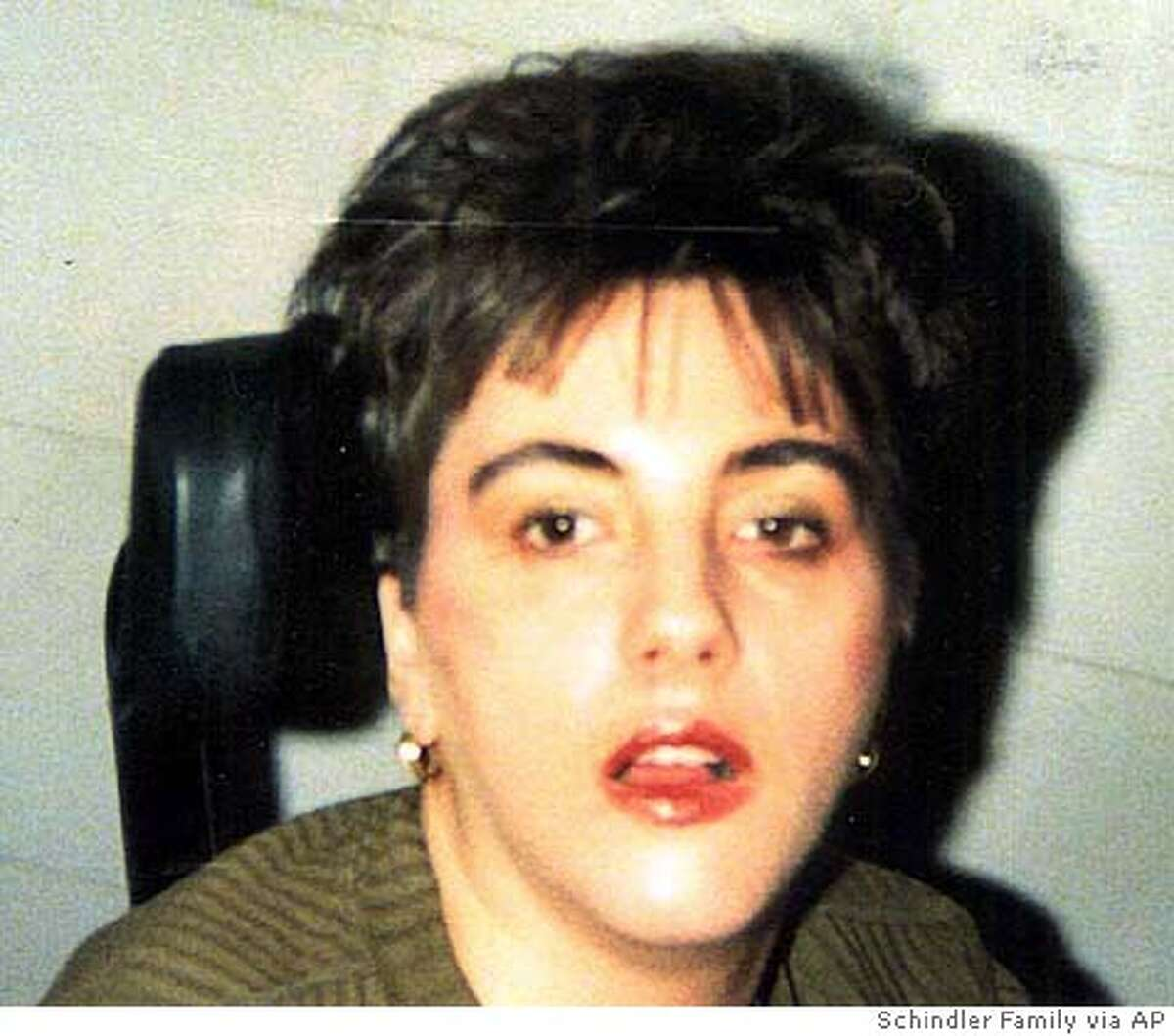 **FILE** Terri Schiavo is shown in this undated Schindler family photo taken shortly after she had a heart attack in 1990. The medical examiner's office plans to release its autopsy report Wednesday on Terri Schiavo _ findings her family hopes will shed light on the cause of the collapse that left her severely brain-damaged 15 years ago. Schiavo, 41, died March 31, nearly two weeks after the feeding tube that had kept her alive was removed under a court order obtained by her husband, Michael Schiavo. (AP Photo/Schindler Family Photo, File) ** **