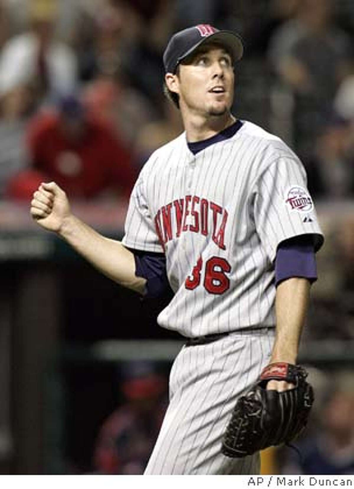 Minnesota Twins closer Joe Nathan starts to celebrate as Cleveland Indians' Jody Gerut's fly ball is caught in right field giving the Twins a 5-4 win in 11 innings Thursday, May 26, 2005, in Cleveland. (AP Photo/Mark Duncan) Ran on: 06-05-2005 Former Giant Joe Nathan is one of baseballs few consistent closers this year, but even Minnesotas stopper wont take it for granted.