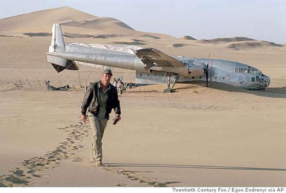 "In this photo provided by Twentieth Century Fox, Dennis Quaid as Captain Frank Town, searches for a missing passenger after his plane crashes in Mongolia's Gobi Desert during a sandstorm in ""Flight of the Phoenix."" (AP Photo/Twentieth Century Fox/ Egon Endrenyi) Photo: EGON ENDRENYI"