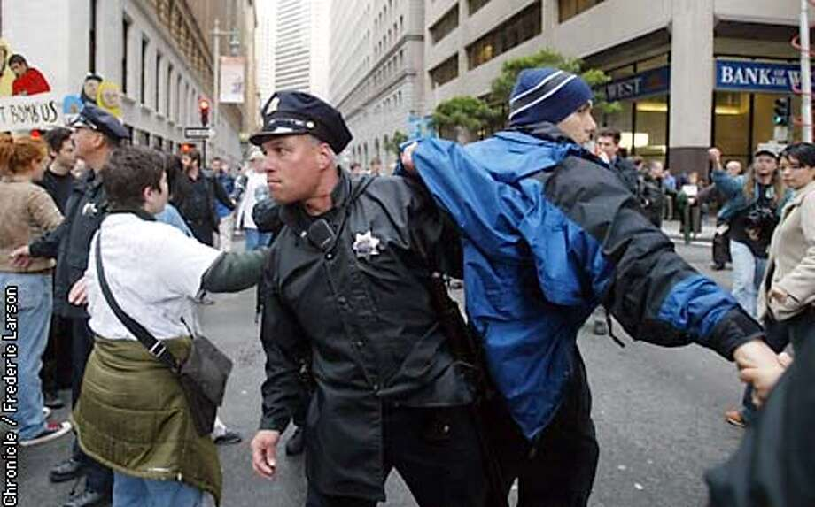 LANGLEY-C-14MAR03-MT-FRL: Several dozen protestors where arrested for blocking streets in the SF Financial district. Activists shut down the Financial District at Bush and Sansome/Market Street with nonviolent civil disobedience. Chronicle photo by Frederic Larson Photo: FREDERIC LARSON