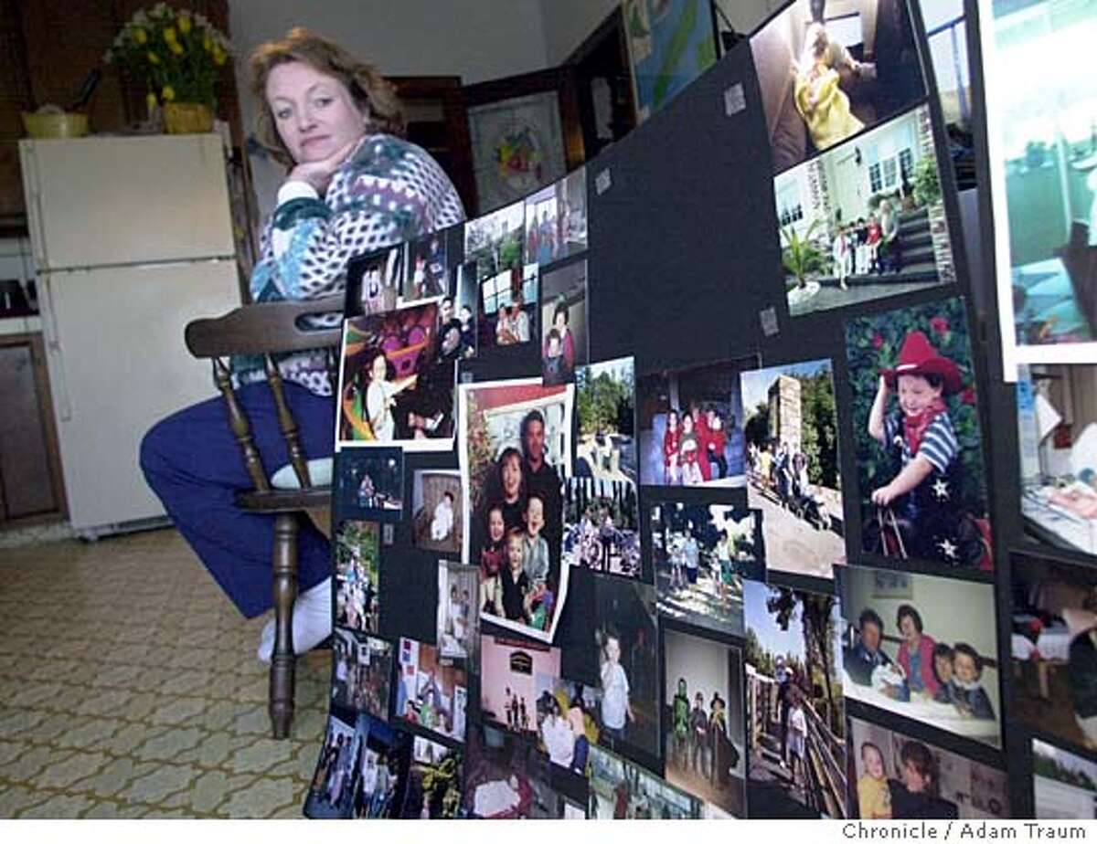 Maureen Fabish, mother of Nicholas Faibish who was killed says that her dogs were great family dogs and slept with her children regularly. Here, Fabish looks at poster boards filled with images of Nicholas that were at his funeral. Chronicle Photo/Adam Traum