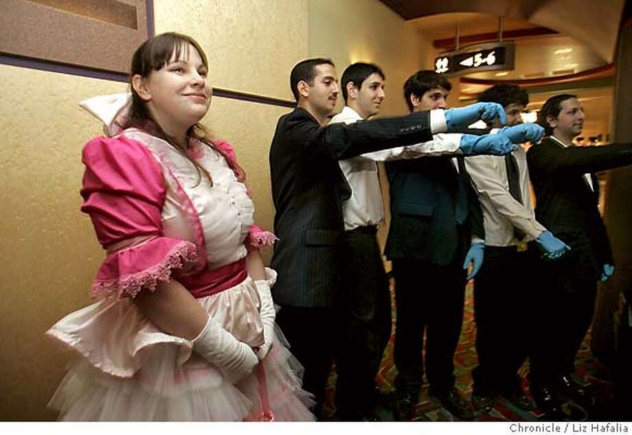 "SERENITY_010_LH.JPG Arielle Kesweder's (left, from San Leandro) mom, Rebecca Kesweder made the dress. She's dressing up as Kayle, a character from Firefly TV show. At right from left to right with blue gloves are Ramzi Kawar, Chris Mogannam, Anthony Mogannam, Alan Saade, and Joey Saade, all from San Jose, in the beginning of the line waiting since 4:00pm. They're dressing as ""blue-handed bad guys'' from the show. In 2002, a series called ""Firefly"" -- created by Joss Whedon of ""Buffy the Vampire Slayer"" and ""Angel"" fame -- aired on the FOX Network. Whedon made a movie, ""Serenity,"" based on the short-lived series, and has scheduled sneak previews of the unfinished cut (""Serenity"" isn't out until Sept.) across the country. Preview screenings at AMC/Van Ness have sold out in minutes. Shot in San Francisco on 5/26/05. In case of name discripancy with story, go with story in this case. Creditted to San Francisco Chronicle/Liz Hafalia Photo: Liz Hafalia"