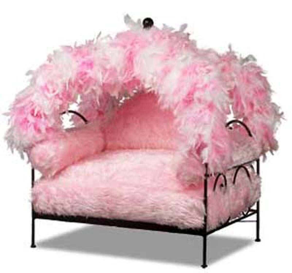 Pink Feather Canopy bed from www.catsplay.com accommodates pets up to 25 pounds; $329 plus $29.99 shipping.