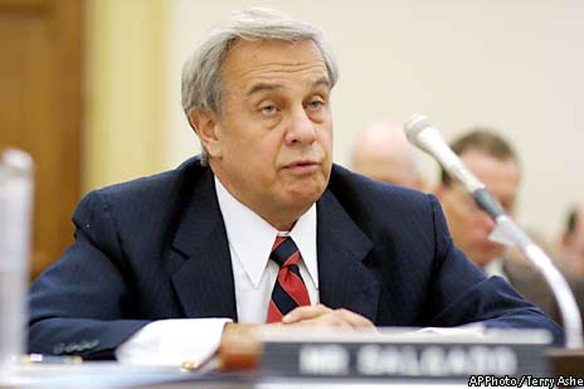 """Joseph Salgado, former principal deputy director of Los Alamos National Laboratory testifies on Capitol Hill Wednesday, March 12, 2003 a House Energy Committee hearing on the nuclear weapons lab. Salgado told the committee he took responsibility for firing the investigators _ Glenn Walp and Steven Doran _ and did so because they had provided """"incomplete, inaccurate information"""" to lab managers. Seventeen senior managers and employees at Los Alamos National Laboratory have been fired or reassigned sinceallegations of widespread fraud and mismanagement at the nuclear weapons facility. (AP Photo / Terry Ashe)"""