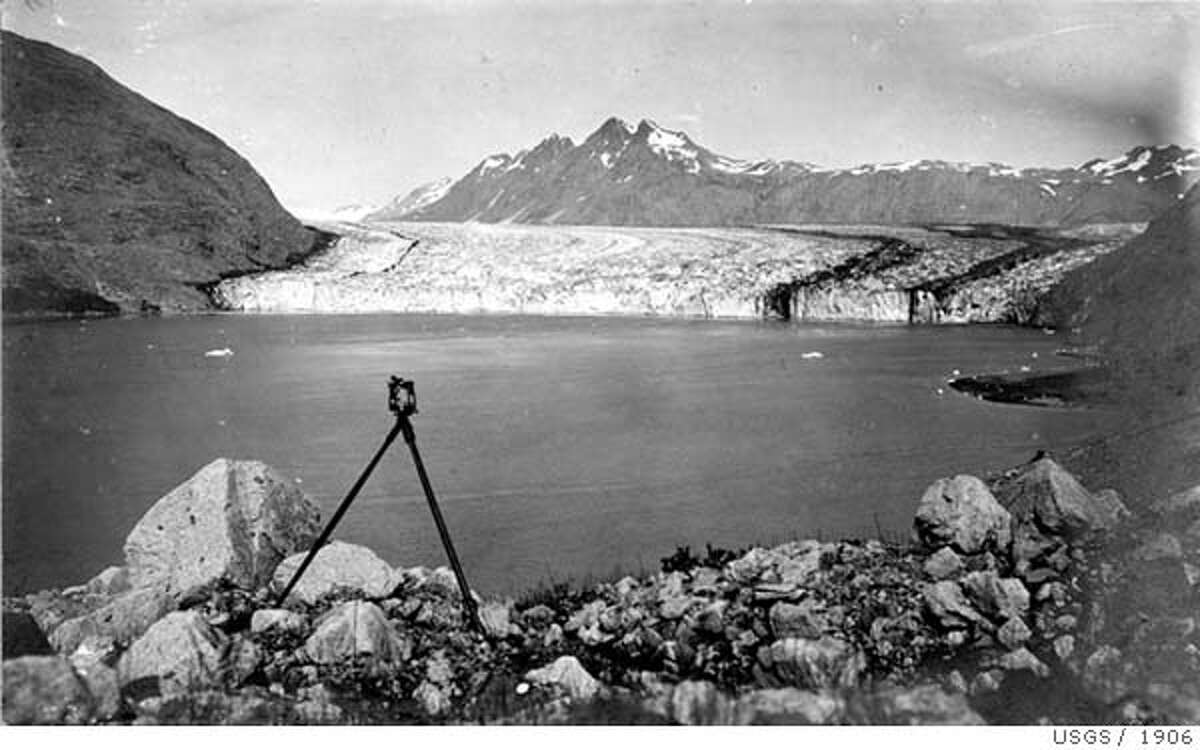 USGS-13-Carroll-1906.jpg Event on 8/1906 in Alaska. USGS � 13 - A pair of northwest-looking photographs, both taken from the same location, several hundred meters up a steep alluvial fan located in a side valley on the east side of Queen Inlet, Glacier Bay National Park and Preserve, Alaska, showing the changes that have occurred to Carroll Glacier and upper Queen Inlet during the 98 years between August 1906 and June 21, 2004. The 1906 photograph shows the calving terminus of Carroll Glacier sitting at the head of Queen Inlet (USGS Photo Library Photograph - Wright 333). No vegetation is visible. The 2004 photograph shows that the terminus of Carroll Glacier has changed to a stagnant, debris-covered glacier that has significantly thinned and retreated from its 1906 position. The head of Queen Inlet has been filled by sediment. An examination of early 20th century nautical charts suggests that the sediment fill exceeds 400 ft. Note the developing vegetation on the sediment fill. USGS Photo
