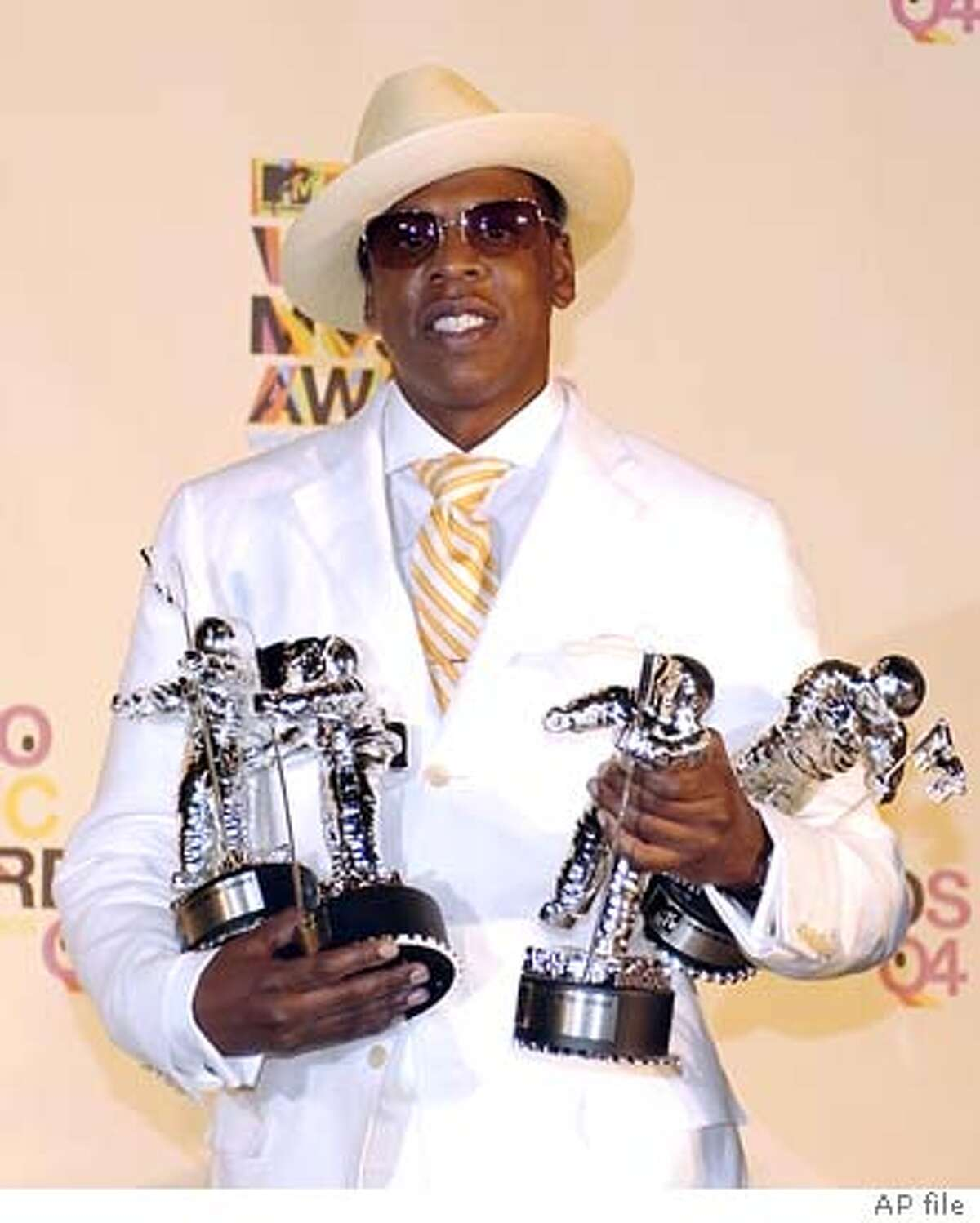 Jay-Z holds his four MTV Video Music awards in Miami, Aug. 29, 2004. Jay-Z won Best Rap Video, Best Direction in a Video, Best Editing and Best Cinematography.