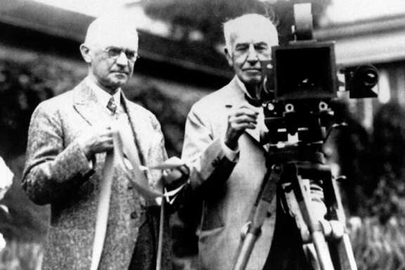FILE - In this late 1920's file photo, Eastman Kodak Co. founder George Eastman, left, and Thomas Edison pose with their inventions. Edison invented motion picture equipment and Kodak invented roll-film and the camera box, which helped to create the motion picture industry. The glory days when Eastman Kodak Co. ruled the world of film photography lasted for over a century.  (AP Photo)