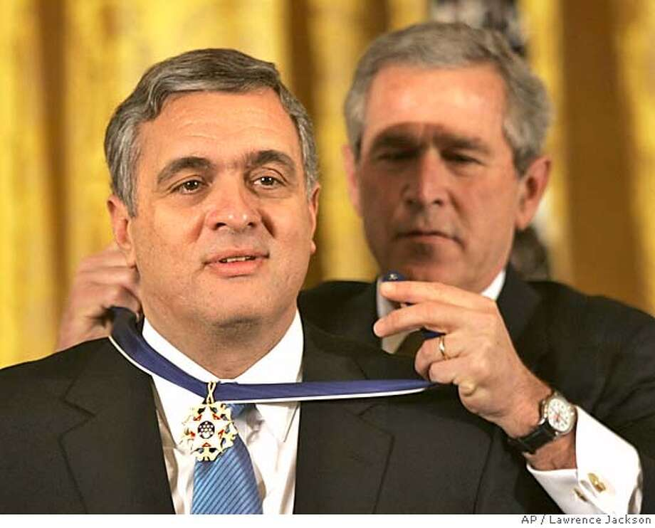 President Bush presents former Central Intelligence Agency director, George Tenet, the Presidential Medal of Freedom Award, the nation's highest civilian honor, in the East Room of the White House, Tuesday, Dec. 14, 2004, in Washington. (AP Photo/Lawrence Jackson) Photo: LAWRENCE JACKSON