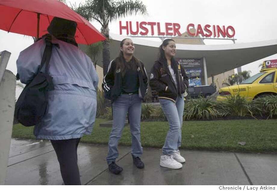 Stephie Velasquez and her sister Maya wait for the bus to go to school in front of the Hustler Casino, Dec. 8, 2004, in Gardena. They have lived in the neighborhood since the Hustler opened which replaced a casino that was burned out years before. The working class city of Gardena , in south Los Angeles is drowning in debt and has become heavily dependent on the Hustler Casino and the Normandy Casino to bring in revenue, Dec. 8, 2004. LACY ATKINS/SAN FRANCISCO CHRONICLE Photo: LACY ATKINS