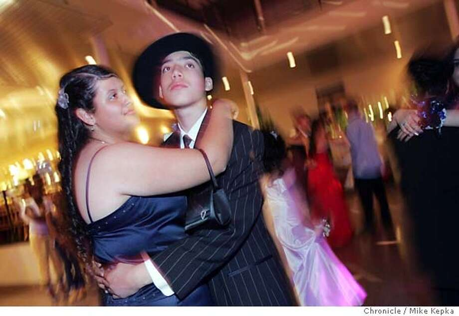 Jerry took an oportunity to dance during a slow song at his senior prom with his date Carla Guilles. Jerry debated going to the prom but finally decided he need to attend after Mrs. Kern baught him a ticket and others suggested he might regret it if he didn't go.  After Mrs. Kern presented him with a ticket to the prom Jerry Hernandez, of Richmond, Calif. is a senior at Mission High School in San Francisco. Despite a learning disability, low economic situation and and many other odds Hernandez has been a great success in high school and will be attending SF State in the fall. 5/26/05 Mike Kepka / The Chronicle Photo: Mike Kepka