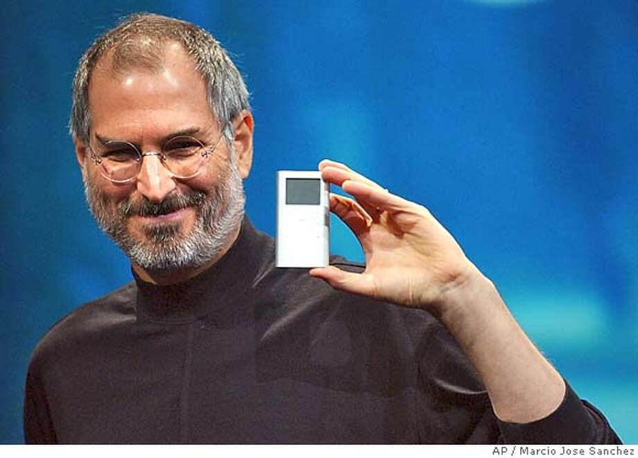 Apple CEO Steve Jobs displays his company's new product, the Mini-Ipod, at the Macworld Conference and Expo in San Francisco, Tuesday, Jan. 6, 2004. (AP Photo/Marcio Jose Sanchez) Ran on: 07-30-2004 Photo: MARCIO JOSE SANCHEZ