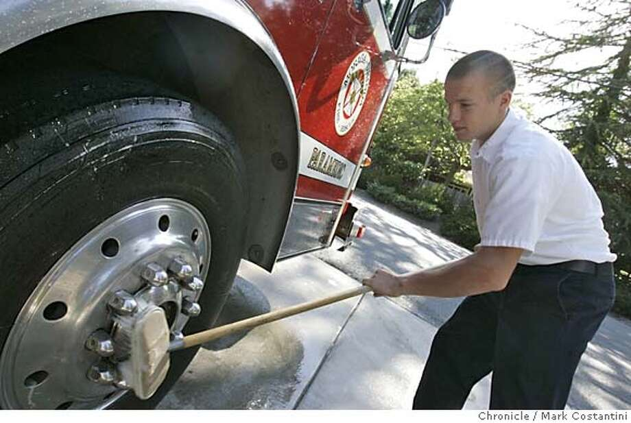 A program at Miramonte High School in Orinda that allows seniors to design their own coursework. This is a senior Chris McGaw washing an engine at an Orinda/Moraga fire station.  Mark Costantini/San Francisco Chronicle Photo: Mark Costantini