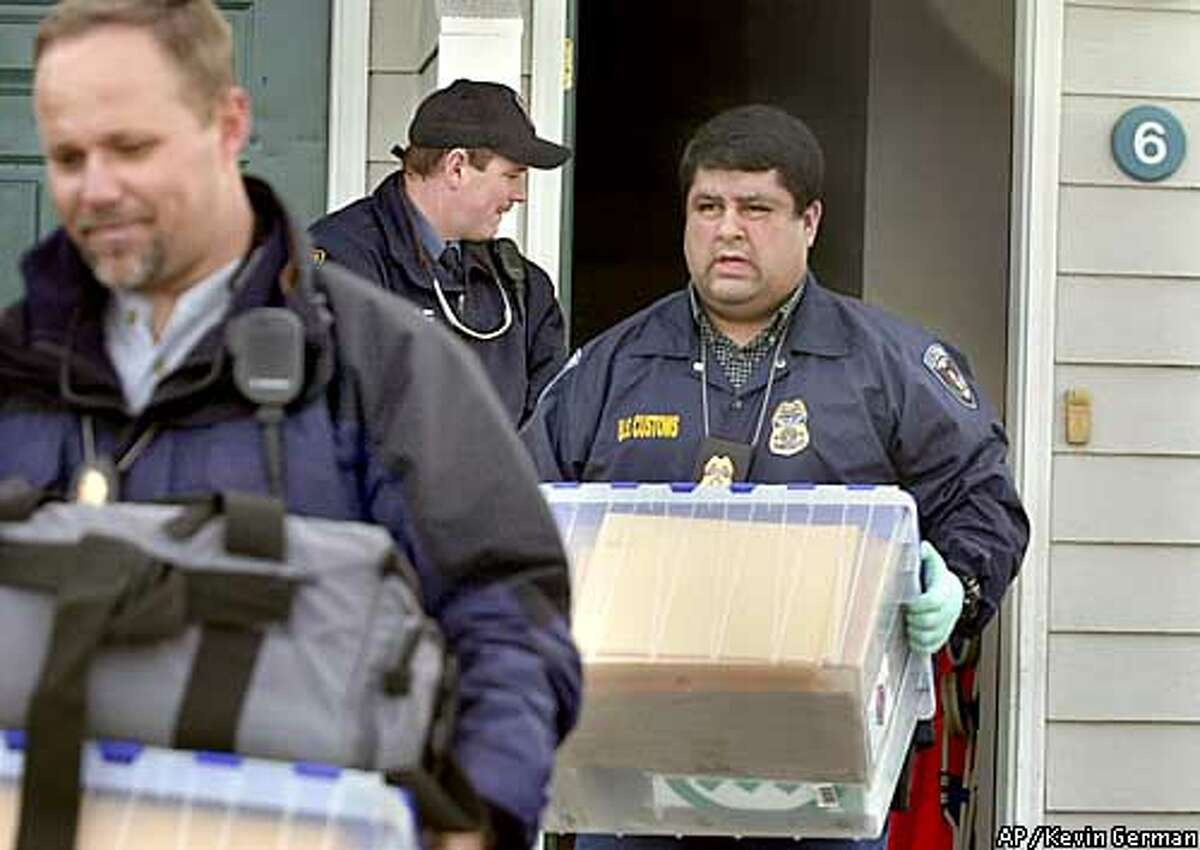 FBI and U.S. Customs agents remove evidence from the home of University of Idaho graduate student Sami Omar Al-Hussayen in Moscow, Idaho, Wednesday, Feb. 26, 2002. Al-Hussayen was arrested Wednesday on allegations he created Web sites for an Islamic group that praised suicide bombings and touted the use of airplanes as terror weapons against the United States. (AP Photo/Kevin German)