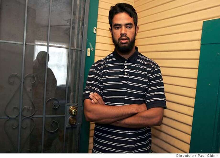 Usama Ismail, 19, nephew and cousin of the men arrested, Umer Hayat and his son Hamid, on terrorism charges, meets with reporters on his front porch. The Muslim community reacts after the arrest of a father and son on terrorism charges for alleged links to an al Qaeda terrorism training camp on 6/8/05 in Lodi, Calif. Two other Muslim clerics are being detained on immigration violations.  PAUL CHINN/The Chronicle Photo: PAUL CHINN