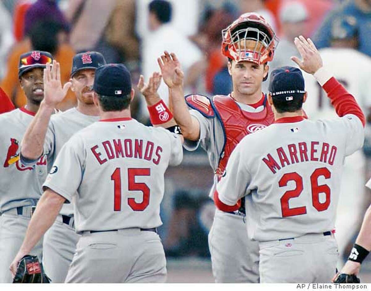 St. Louis Cardinals Woody Williams, second from left, Jim Edmonds, Mike Matheny, second from right, and Eli Marrero celebrate after their 5-4 win over the San Francisco Giants during game three of the NLCS in San Francisco, Saturday, Oct. 12, 2002. (AP Photo/Elaine Thompson) Ran on: 12-13-2004 Felipe Alou addresses the steroid controversy. Page G4