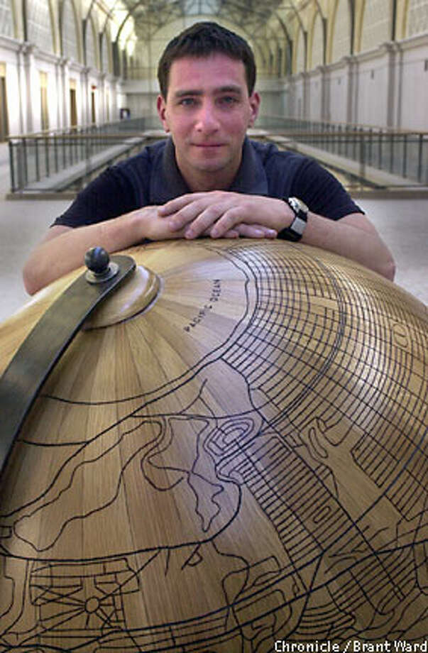 "Sculptor, furniture designer and taxi driver Mike Farruggia is on top of the world with ""Planet San Francisco,"" a wooden globe sculpure which will be on display starting March 21 at the revamped Ferry Building (Port Commission Hearing Room). Chronicle photo by Brant Ward"