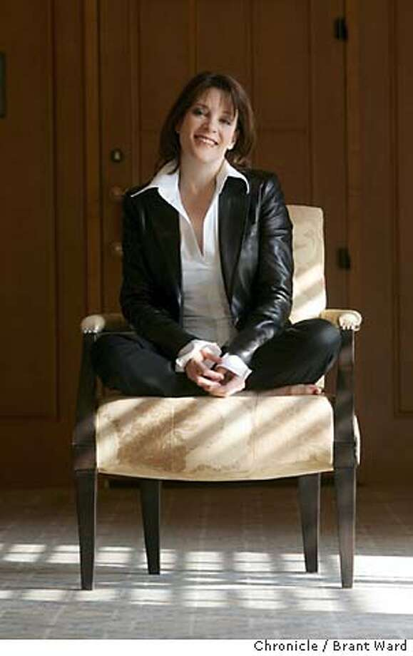 "fivequestions175_ward.jpg  Bestselling new age author Marianne Williamson is promoting her new book ""The Gift of Change: Spititual Guidance for a Radically New Life.""  She is photographed at Four Seasons Hotel in San Francisco. Brant Ward 12/6/04 Photo: Brant Ward"