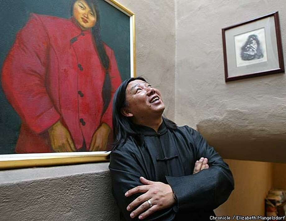 Artist Pop Zhao in his home in the Sunset district of San Francisco. Zhao, a Chinese Native living in SF will be covering the the entire new Asian Arts Museum with thousands of yards of canvas showing various Asian artworks. His art is on the walls, which includes a painting he did 10 years ago (woman on left).  Photo by Liz Mangelsdorf/chronicle Photo: Liz Mangelsdorf