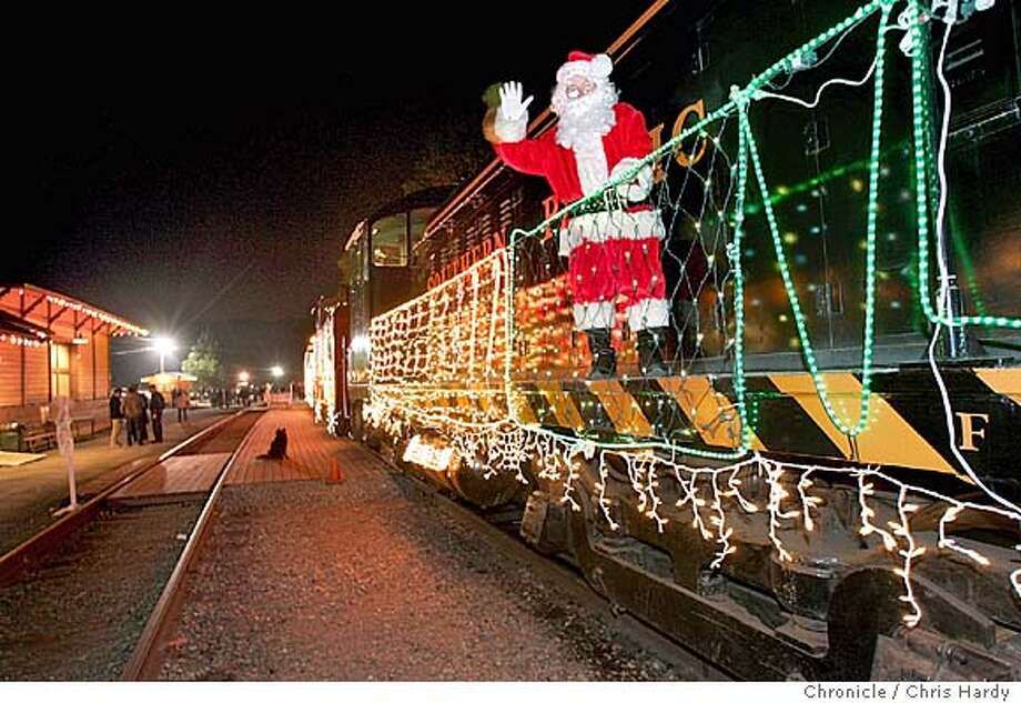 The Niles Canyon Railway's annual holiday Train of Lights . Stationmaster Al McCracken at Sunol station watches train depart .  in Sunol,CA on 12/5/04  San Francisco Chronicle/Chris Hardy Photo: Chris Hardy