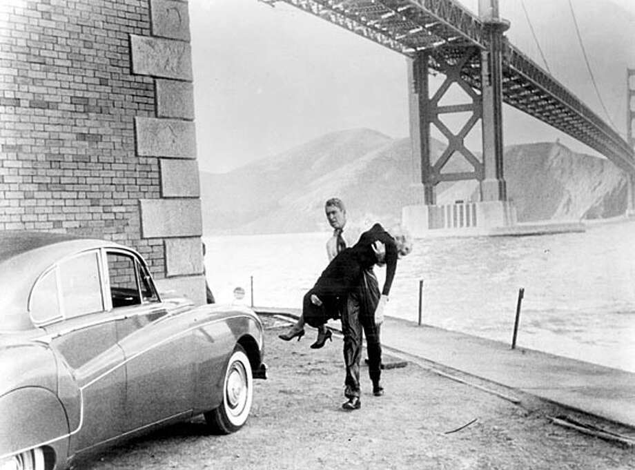 "SFFILM14C-B-19DEC00-PK-HO ""Vertigo"" starring James Stewart and Kim Novak. Ran on: 04-17-2005  Above, James Stewart and Kim Novak at Fort Point under the Golden Gate Bridge in &quo;Vertigo.&quo; Below, Andy Robinson takes aim in &quo;Dirty Harry,&quo; with the cityscape and Alcatraz behind him. BookReview#BookReview#Chronicle#06-05-2005#ALL#2star#E3#421804763 BookReview#BookReview#Chronicle#06-05-2005#ALL#2star#E3#421804763 Photo: Paramount Pictures"