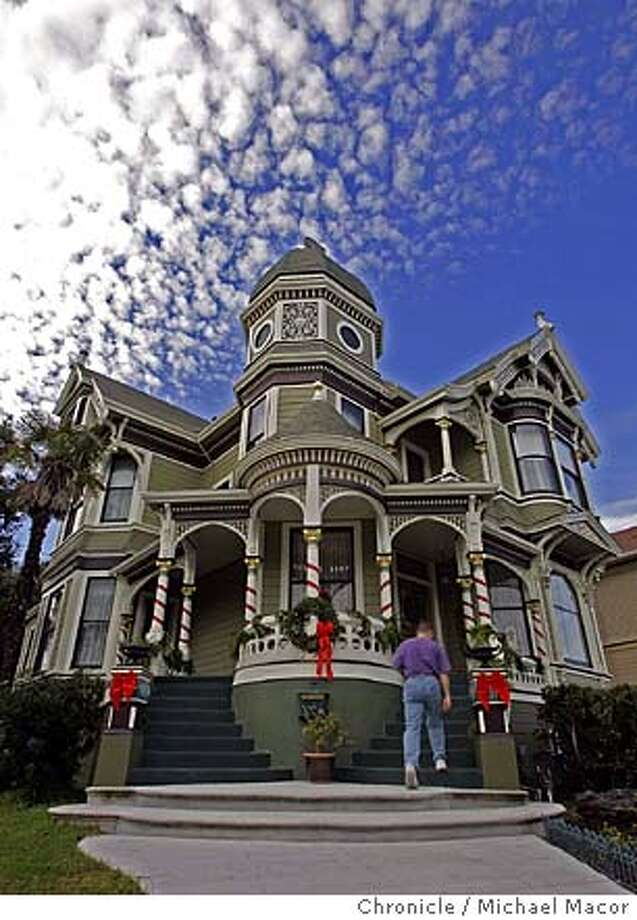Decortations greet visitors coming up the front walk. Mark White's 1894 Victorian home in Alameda, all set for the Christmas Holiday, set for a public tour of several homes throughout the City of Alameda.  12/4/04 Alameda, CA Michael Macor / San Francisco Chronicle Photo: Michael Macor