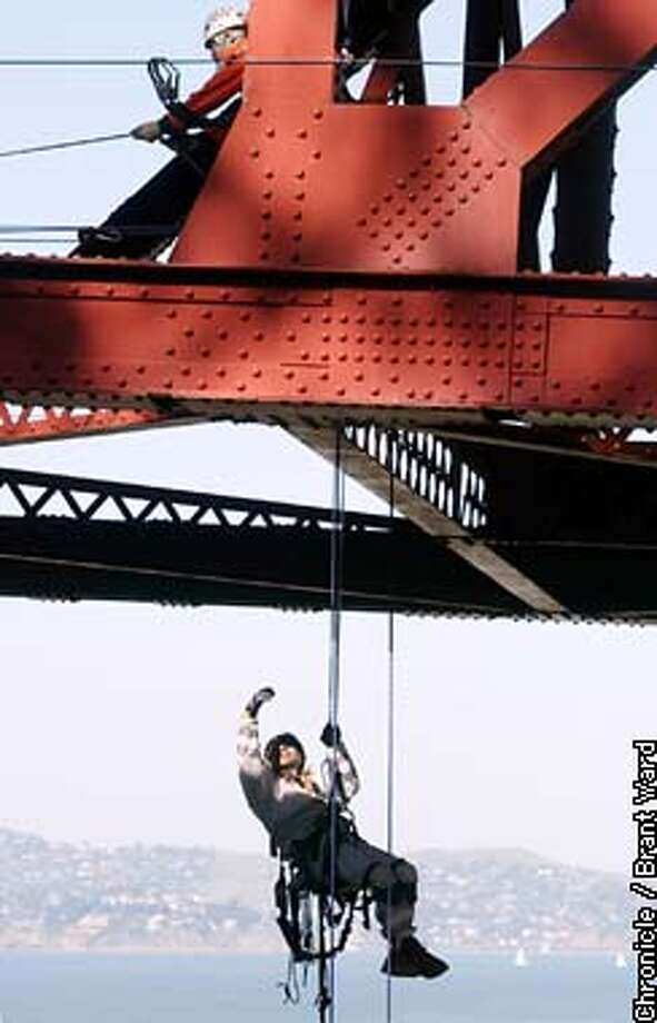 CALTRANS bridge maintainance engineers practiced their rope technique Wednesday in preparation for Bay Area bridge inspections. The engineers like Rafael Motes, at end of rope, ensure the structural integrity of Bay Area bridges by climbing all over them. Here they practiced off Doyle Drive in the Presidio for their next bridge inspection. By Brant Ward/Chronicle Photo: BRANT WARD