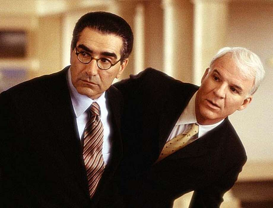 THIS IS A HANDOUT IMAGE. PLEASE VERIFY RIGHTS. Peter (Steve Martin, right) and Howie (Eugene Levy, left) find themselves hiding out from Charlene (Queen Latifah) in their law office in the film �Bringing Down the House,� directed by Adam Shankman from a screenplay by Jason Filardi. Photo: HO