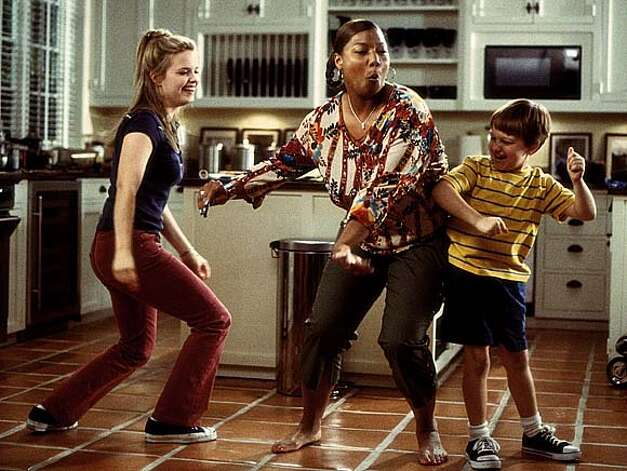 THIS IS A HANDOUT IMAGE. PLEASE VERIFY RIGHTS. Charlene ( Queen Latifah, center) gets down and boogies with Peter�s kids, Sarah (Kimberly J. Brown, left) and Georgey (Angus T. Jones, right). �Bringing Down the House,� directed by Adam Shankman from a screenplay by Jason Filardi. Photo: HO