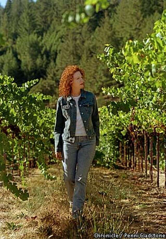 Kate MacMurray, now steward of the 1,750-acre ranch formerly owned by her father, Fred MacMurray, strolls through the vineyards. Chronicle photo by Penni Gladstone