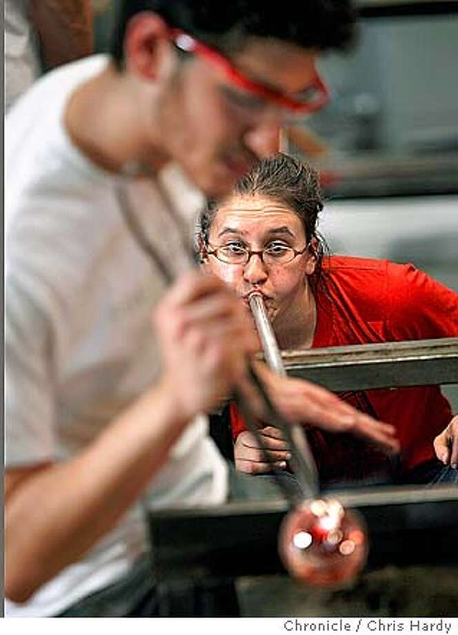 Volunteer glassblowers at Public Glass creating Christmas tree ornaments, which will be sold to the public as a fundraiser for the nonprofit group at a store in the Crocker Galleria. in San Francisco,CA on 11/28/04  San Francisco Chronicle/Chris Hardy Photo: Chris Hardy