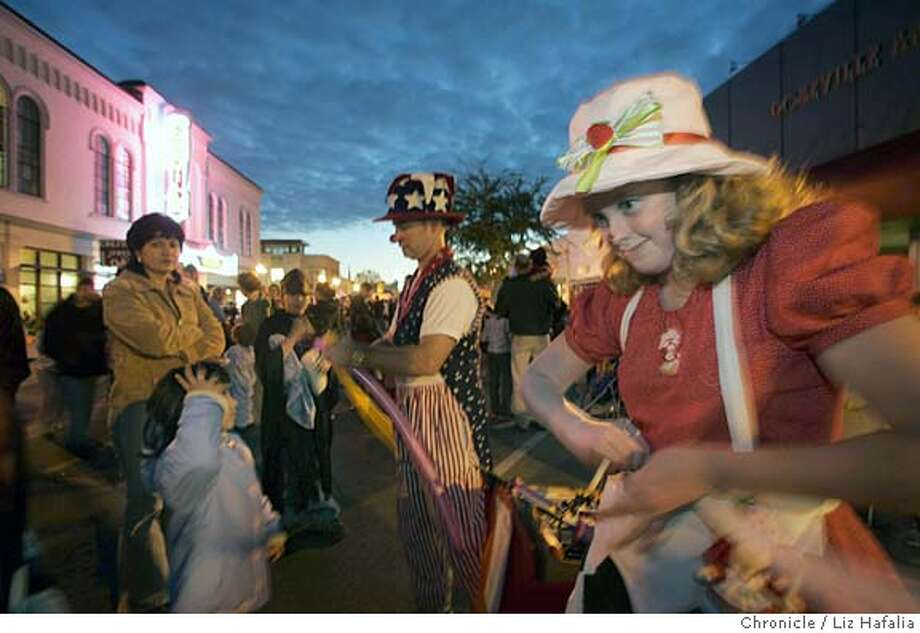 "Trina Branaugh is the 15-year-old girl had brain surgery at Stanford to remove a tumor from her brain stem. Only 2 weeks after the surgery she has already returned to the family gig of ""clowning"" at a Halloween street fair in Roseville. Shot on 10/28/04 in Rocklin. LIZ HAFALIA/The Chronicle Photo: Liz Hafalia"
