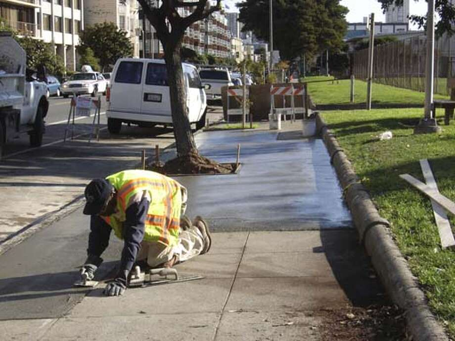 """Handout images from Frank Lee of SF Public Works of the repairs to sidewalk at Hamilton Community Center on Post St. For results story."""