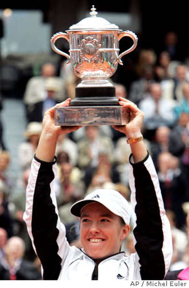 Belgium's Justine Henin-Hardenne holds aloft the trophy after defeating France' s Mary Pierce in their final match of the French Open tennis tournament, at the Roland Garros stadium, Saturday June 4, 2005 in Paris. Henin-Hardenne won 6-1, 6-1. (AP Photo/Michel Euler) Photo: MICHEL EULER