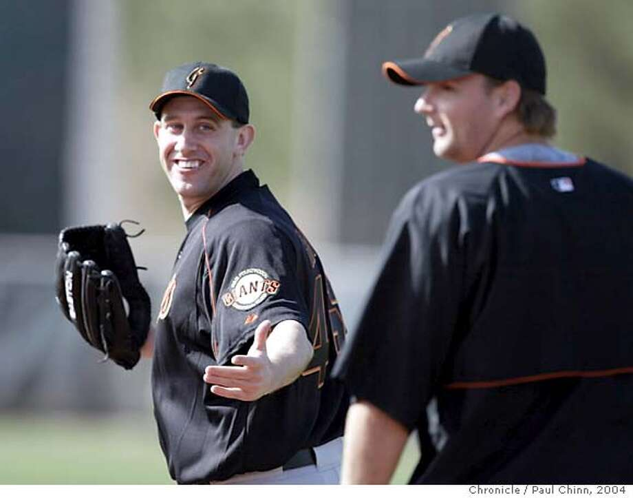 giants22_010_pc.JPG Kirk Rueter smiles back at the Giants' new catcher A.J. Pierzynski (right) at Rueter's first appearance of spring training Saturday. The San Francisco Giants spring training workout on 2/21/04 in Scottsdale, AZ. PAUL CHINN / The Chronicle MANDATORY CREDIT FOR PHOTOG AND SF CHRONICLE/ -MAGS OUT Photo: PAUL CHINN