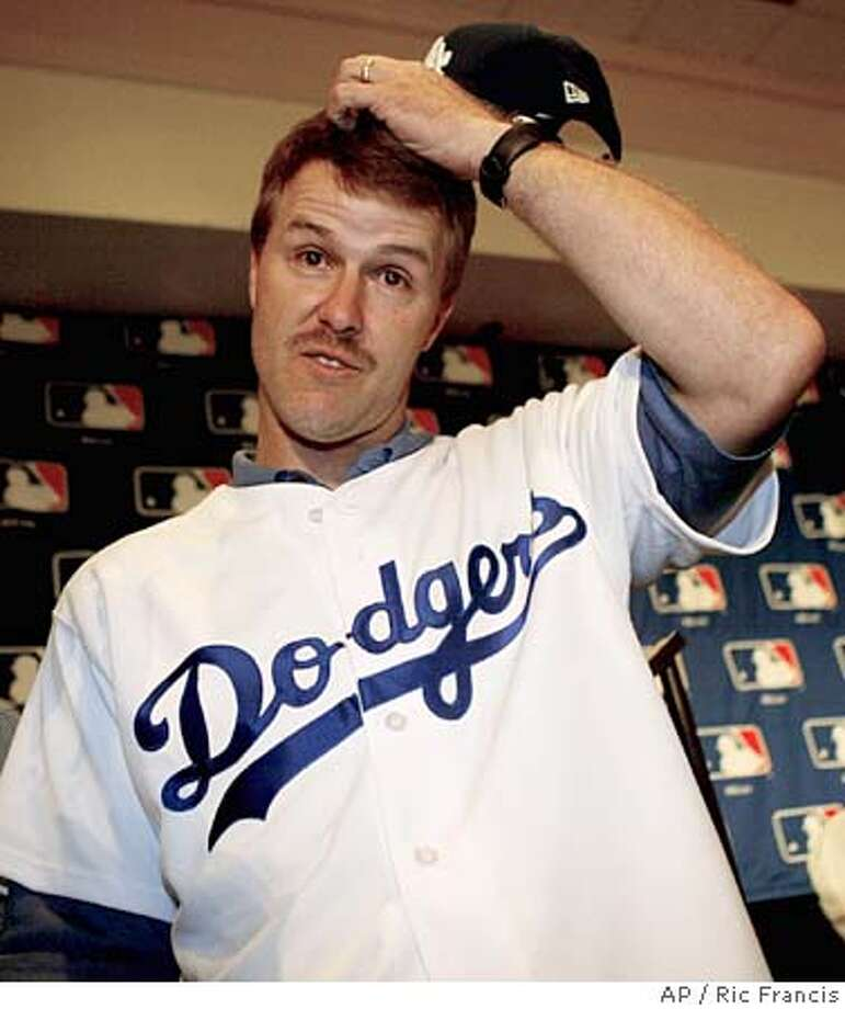 All-Star second baseman Jeff Kent takes questions from reporters Thursday, Dec. 9, 2004, in Anaheim, Calif. The Los Angeles Dodgers announced Thursday that they have agreed to terms with Kent on a $17 million, two-year contract. Kent, 36, hit .289 with 27 homers and 107 RBIs for the Houston Astros last season. (AP Photo/Ric Francis) Photo: RIC FRANCIS