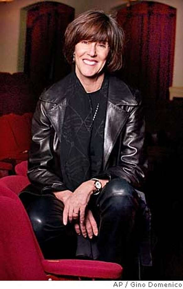 """Author and playwright Nora Ephron poses inside the Barrymore Theatre in New York, Dec. 11, 2002, where her play """"Imaginary Friends"""" opened the next day. The comedy with music concerns the feud between writers Lillian Hellman and Mary McCarthy. AP Photo/Gino Domenico) Photo: GINO DOMENICO"""