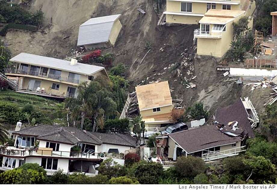 A landslide in the Bluebird canyon area of Laguna Beach saturated by unusually heavy winter rains gave way, destroying at least nine homes and damaging more than 20 others. Photo was taken from Summit Drive looking north across Bluebird Canyon. Photo taken June 1, 2005. ***MANDATORY CREDIT: Mark Boster/Los Angeles Times MANDATORY CREDIT*** , , NO FOREIGN, NO MAGS, LOS ANGELES DAILY NEWS OUT, OC REGISTER OUT, VENTURA COUNTY STAR OUT, INLAND VALLEY DAILY BULLETIN OUT, SAN BERNARDINO SUN OUT Photo: Mark Boster