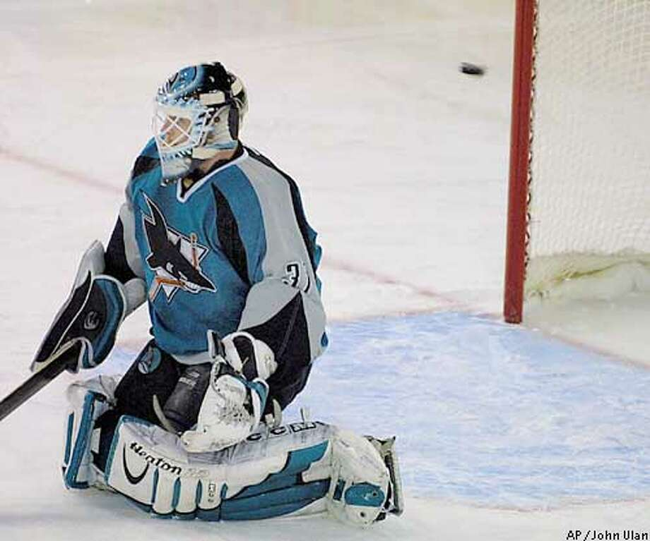 San Jose Sharks' goalie, Miikka Kiprusoff misses the scoring shot from Edmonton Oilers' Ryan Smyth during the first period of NHL play in Edmonton on Tuesday, March 4, 2003. (AP Photo/John Ulan) Photo: JOHN ULAN