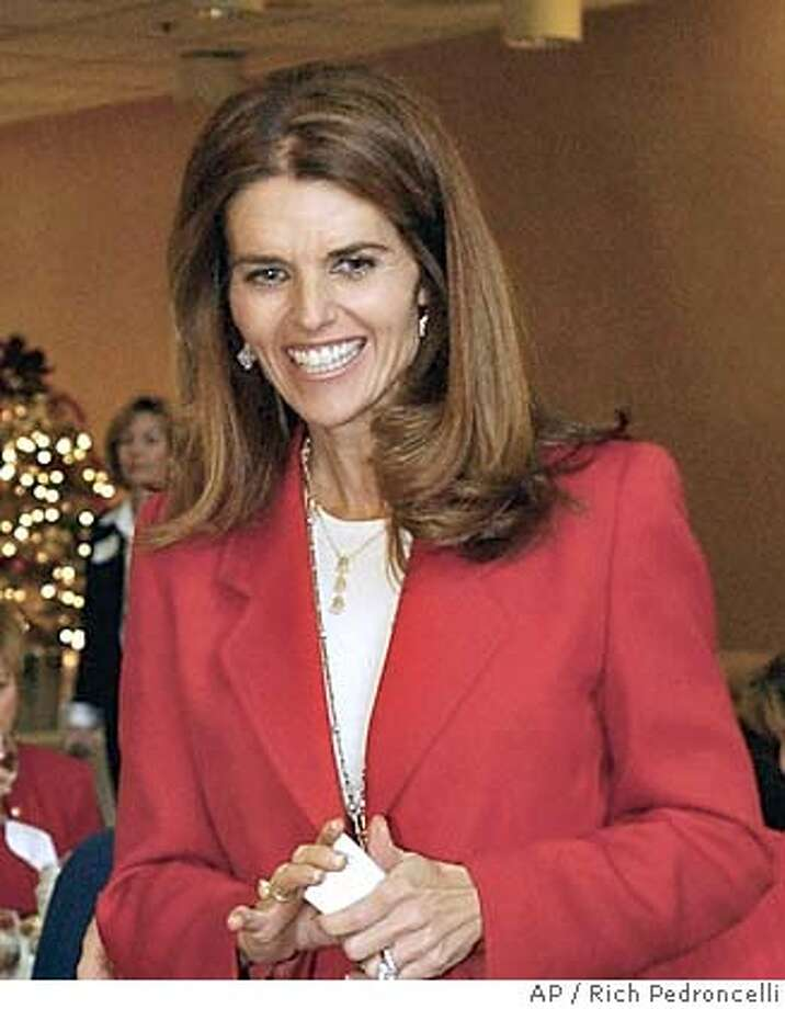 **FILE**Maria Shriver, wife of Gov. Arnold Schwarzenegger, attends a luncheon held in her honor in Sacramento, Calif., on Dec. 9, 2003. She believes there should be an amendment to the U.S. Constitution that would allow her husband to run for president -- but she has her doubts that it will be enacted. (AP Photo/Rich Pedroncelli) A DEC 9 2003 FILE PHOTO Photo: RICH PEDRONCELLI