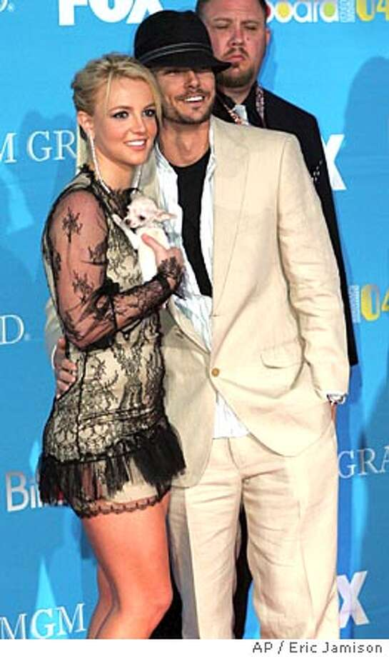 Britney Spears & husband Kevin Federline pose on the red carpet during The Wednesday, Dec. 8, 2004 at the MGM Grand Garden Arena in Las Vegas. (AP Photo/Eric Jamison) Photo: ERIC JAMISON