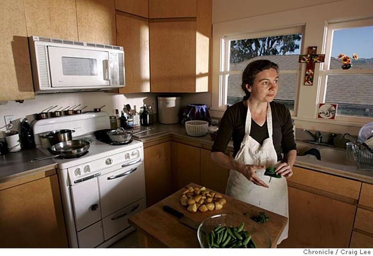Photo of Jessica Prentice preparing food in her kitchen. Cooking with Jessica Prentice, the cookbook author who is promoting