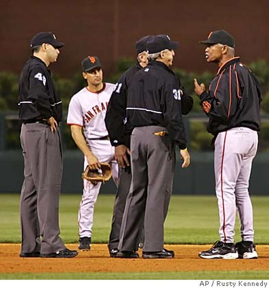 San Francisco Giants manager Felipe Alou,right, argues with umpires after the Philadelphia Phillies scored the go ahead run in the 7th inning Wednesday, June 1, 2005 in Philadelphia. Listening is Giants Omar Vizquel. Alou was ejected from the game. (AP Photo/Rusty Kennedy) Photo: RUSTY KENNEDY
