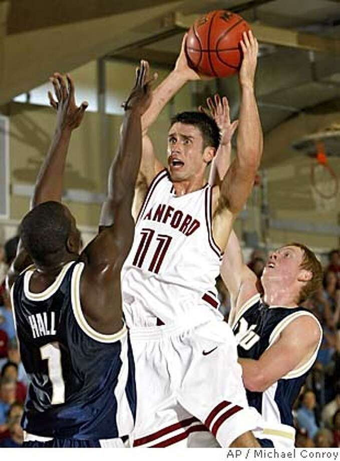Stanford's Chris Hernandez, center, pulls down a long rebound between BYU's Mike Hall, left, and Mike Rose in the first half in the consolation bracket of the Maui Invitational in Lahaina, Hawaii, Tuesday, Nov. 23, 2004. (AP Photo/Michael Conroy) Ran on: 11-24-2004  Stanford's Chris Hernandez pulls down a rebound between BYU's Mike Hall (left) and Mike Rose in the first half of Tuesday's game. Ran on: 11-24-2004  Stanford's Chris Hernandez pulls down a rebound between BYU's Mike Hall (left) and Mike Rose in the first half of Tuesday's game. Ran on: 11-24-2004  Stanford's Chris Hernandez pulls down a rebound between BYU's Mike Hall (left) and Mike Rose in the first half of Tuesday's game. Photo: MICHAEL CONROY