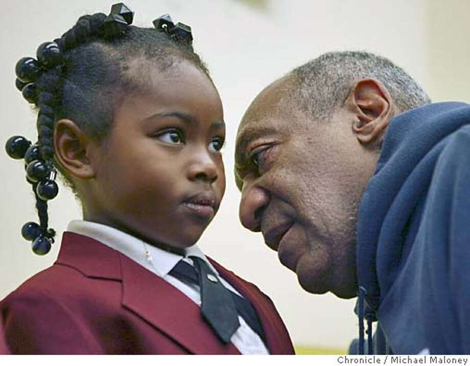 "Bill Cosby has some private words of encouragement to 5 year old kindergartner Jaida Manuel. Months after blasting the African American community for failing to keep their children in school and out of jail, actor/comedian Bill Cosby visited the Bayview-Hunter's Point area on Thursday to tour the Dr. Charles Drew College Preparatory Academy, one of the San Francisco school district's new ""Dream Schools."" SF schools Superintendent Arlene Ackerman wrote him a letter over the summer, asking him to visit the new schools where children wear uniforms, do homework nightly and are taught about college in kindergarten. This particular school taught kids Pre-K through 3rd grade.  Photo by Michael Maloney / San Francisco Chronicle Photo: Michael Maloney"