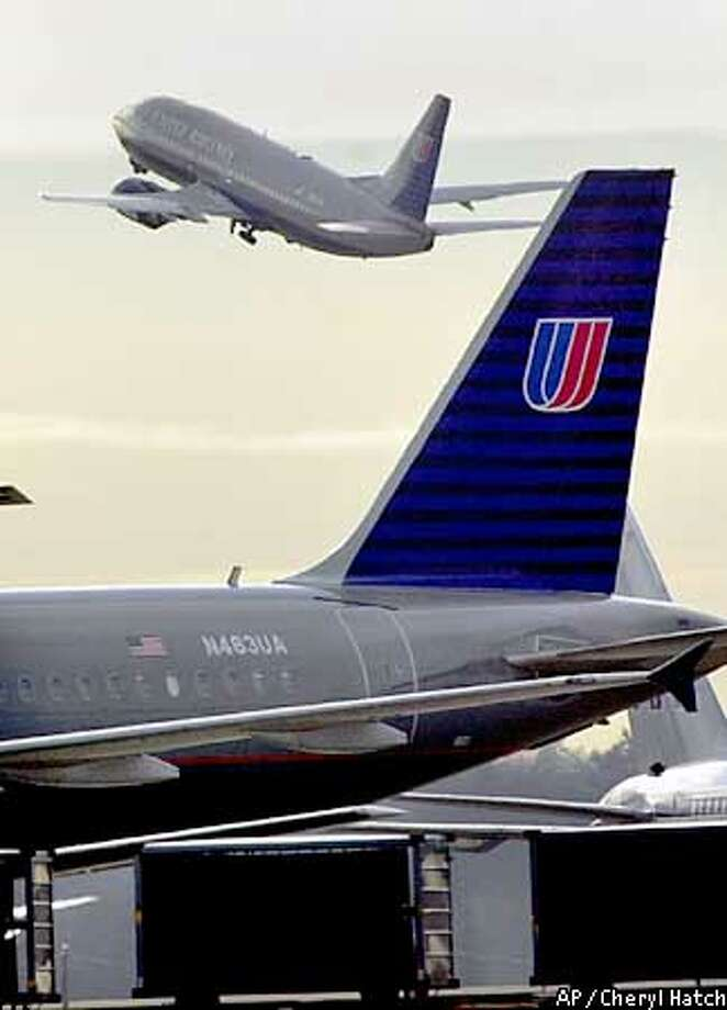 "A jet takes off from Seattle-Tacoma International Airport in SeaTac, Wash. on Thursday afternoonl, Dec. 5, 2002. stock lost two-thirds of its value Thursday amid rampant speculation that the world's second-largest carrier can do nothing except file for bankruptcy. The New York Stock Exchange had stopped trading in United parent UAL Corp.'s shares for most of the morning because of ""news that's pending that could materially affect the trading of the stock,"" NYSE spokesman Ray Pellecchia said. (AP Photo/Cheryl Hatch) Photo: CHERYL HATCH"
