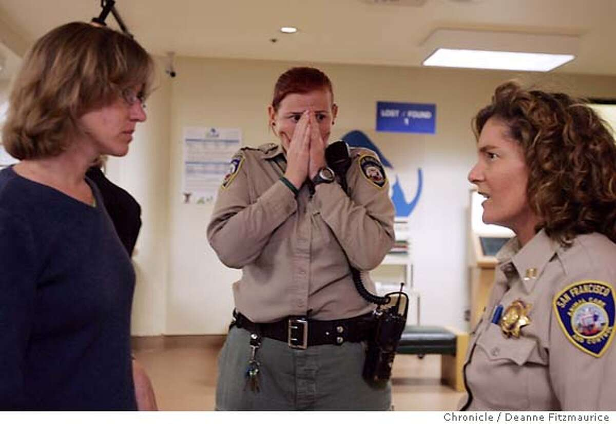 After being some of the first to arrive on the scene, Animal Control officers Elllie Sadler (center) and Vicky Guldbech (right) describe the scene to dog behaviorist Donna Duford (left) moments after they return to San Francisco Animal Care and Control with dog named Rex who is brought in a cage to San Francisco Animal Care and Control after being found at the scene of a fatality where a boy named Nicholas Scott Faibish was mauled. San Francisco Chronicle/ Deanne Fitzmaurice