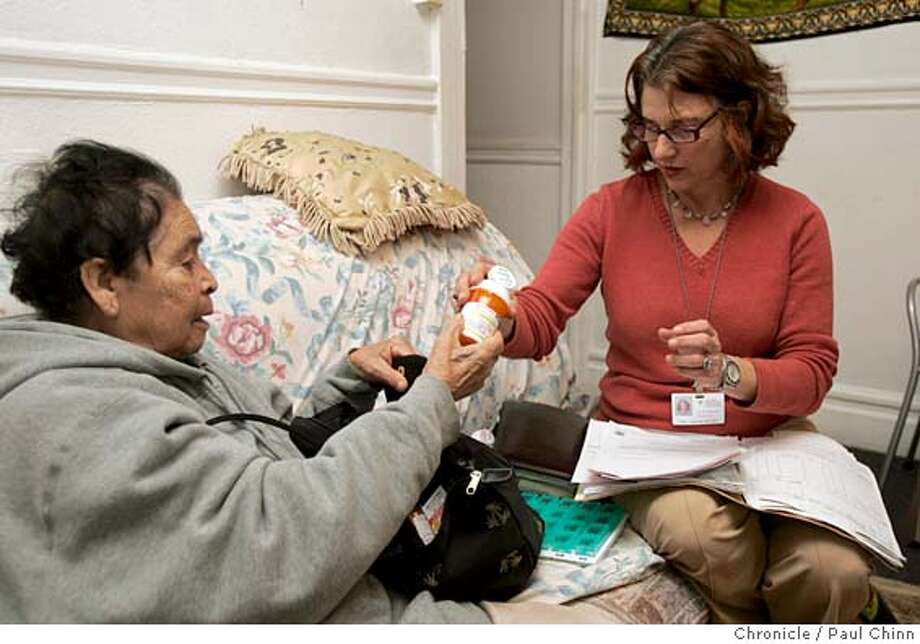 sfbudget09_003_pc.jpg  Ellen Sakoloff (right) helps Esperanza Leon keep track of ten different prescription drugs she needs to take. Public health nurse Ellen Sakoloff visits patient Esperanza Leon at her Mission district home on 12/8/04 in San Francisco, CA. Cuts in the city's budget could slash the number of public health nurses that make regular in-home visits.  PAUL CHINN/The Chronicle MANDATORY CREDIT FOR PHOTOG AND S.F. CHRONICLE/ - MAGS OUT Photo: PAUL CHINN