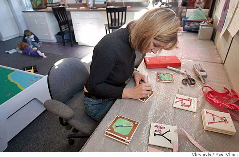 life07_023_pc.jpg  Jamie Lentzner details a ceremic tile while her children Abby and Grant occupy themselves (upper left). Ceramic tile designer Jamie Lentzner runs her business from her home and is a full-time mom as well on 12/3/04 in Foster City, CA.  PAUL CHINN/The Chronicle MANDATORY CREDIT FOR PHOTOG AND S.F. CHRONICLE/ - MAGS OUT Datebook#Datebook#Chronicle#12/07/2004##Advance##0422498594 Photo: PAUL CHINN