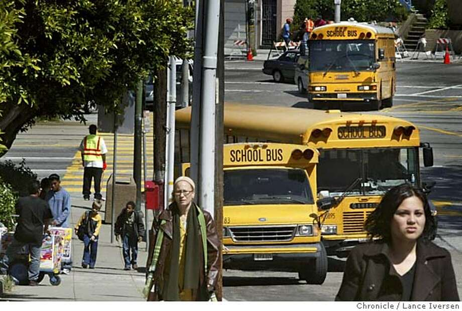 SFSCHOOLS29_003.jpg_  What is the future of the S.F. school district's busing system once the federal court order mandating desegregation expires:  children from Fairmount Elementary School is San francisco rush to be picked up. By Lance Iversen/San Francisco Chronicle MANDATORY CREDIT PHOTOG AND SAN FRANCISCO CHRONICLE. Photo: Lance Iversen